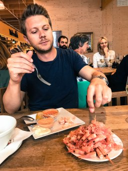 Gaetan learning to peel shrimp at Östermalms Saluhall